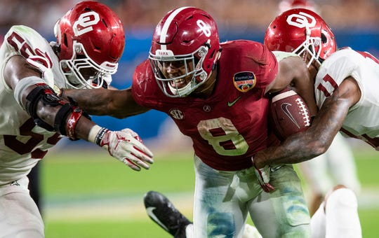 Alabama running back Josh Jacobs (8) carries the ball in second half action of the Orange Bowl at Hard Rock Stadium in Miami Gardens, Fla., on Saturday December 29, 2018.