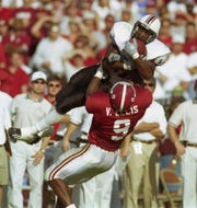 Alabama linebacker Victor Ellis makes a tackle against South Carolina. Ellis played for the Crimson Tide from 1998-2001.