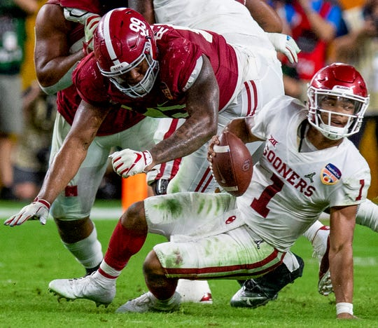 Alabama defensive lineman Raekwon Davis (99) stops Oklahoma quarterback Kyler Murray (1) in second half action of the Orange Bowl at Hard Rock Stadium in Miami Gardens, Fla., on Saturday December 29, 2018.
