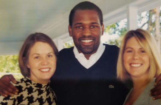 Victor Ellis with Tim and Kathy Miller's daughters Jenny, left, and Kristyn.