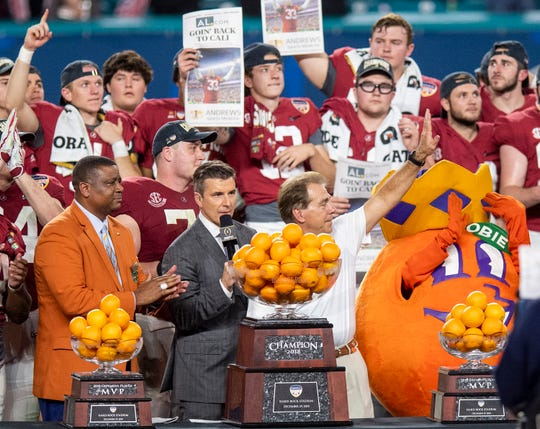 Alabama head coach Nick Saban waves to fans as Alabama is presented the trophy after winning the Orange Bowl at Hard Rock Stadium in Miami Gardens, Fla., on Saturday December 29, 2018.