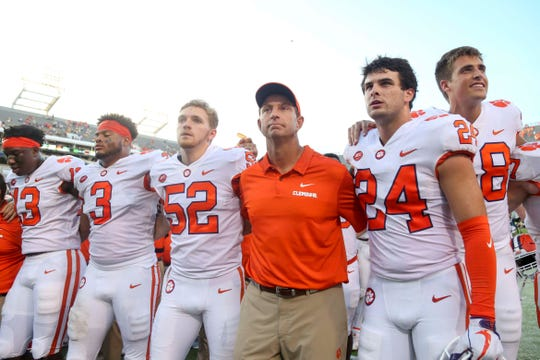 Sep 22, 2018; Atlanta, GA, USA; Clemson Tigers head coach Dabo Swinney celebrates a victory with defensive lineman K.J. Henry (13) and defensive lineman Xavier Thomas (3) and long snapper Austin Spence (52) and safety Nolan Turner (24) against the Georgia Tech Yellow Jackets at Bobby Dodd Stadium. Mandatory Credit: Brett Davis-USA TODAY Sports