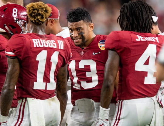 Alabama quarterback Tua Tagovailoa (13) talks with running back Josh Jacobs (8), wide receiver Henry Ruggs, III, (11) and wide receiver Jerry Jeudy (4) in first half action of the Orange Bowl at Hard Rock Stadium in Miami Gardens, Fla., on Saturday December 29, 2018.