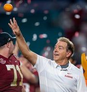 Alabama head coach Nick Saban thaws oranges as his team celebrates winning the Orange Bowl at Hard Rock Stadium in Miami Gardens, Fla., on Saturday December 29, 2018.