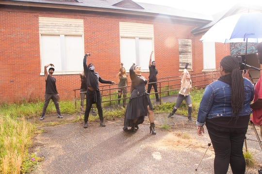 Tatyana Webb and her ReBeL group dance in a scene from her new music video, shot at an old school building near Troy.