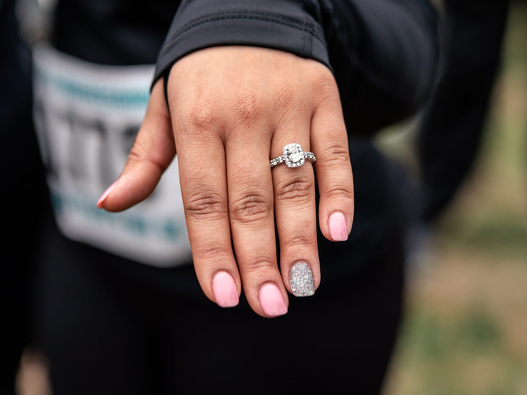 Tiffany Smith shows off her engagement ring after her boyfriend, Joshua Crutchfield, proposed to her following they crossed the finish line at the Murfreesboro New Year's Day 5K.