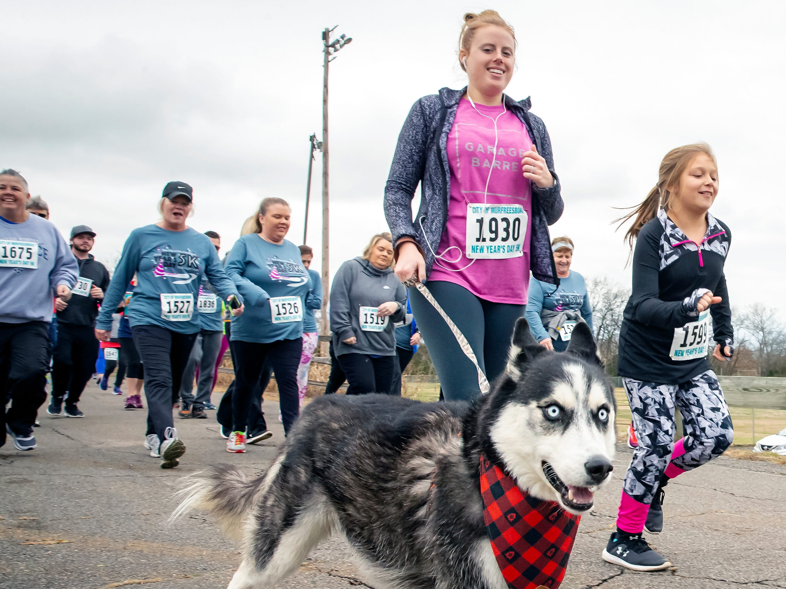 MacKenzie Faneli and her dog get started the New Year's Day 5K event held at Old Fort Park on Jan. 1, 2019.
