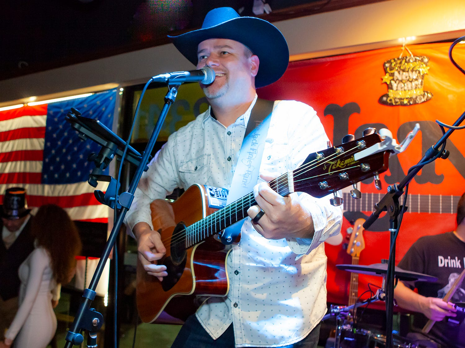 Jack Finley of  Jack Finley Band entertains the crowd at the New Year's party at Hank's Honky Tonk in Murfreesboro.