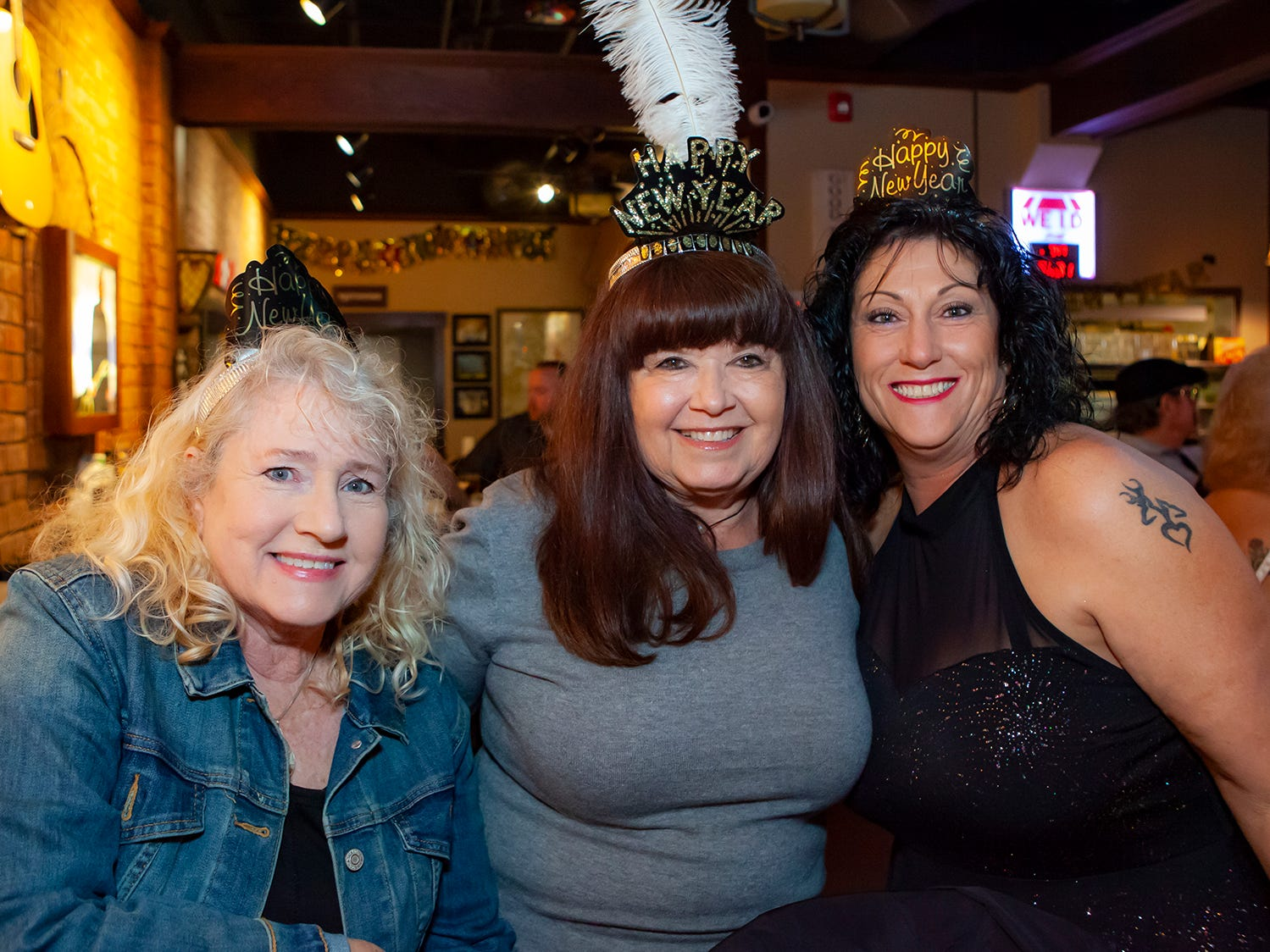 Katie Christian, Barbara Law and Vickie Lucas at the New Year's party at Hank's Honky Tonk in Murfreesboro.