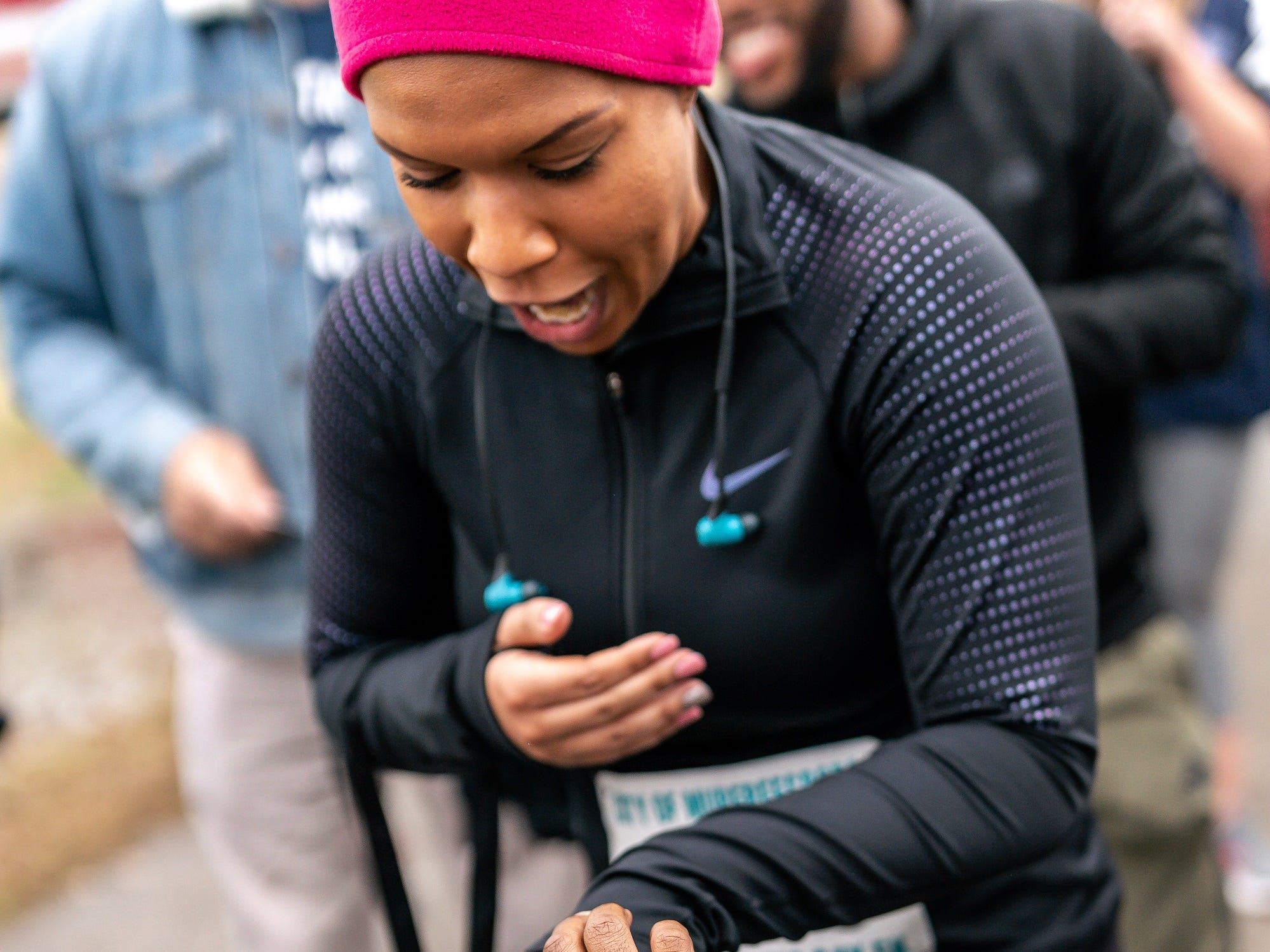 Tiffany Smith shows shock on her face after long-time boyfriend, Joshua Crutchfield, proposes to her after they finished the Murfreesboro New Year's Day 5K.