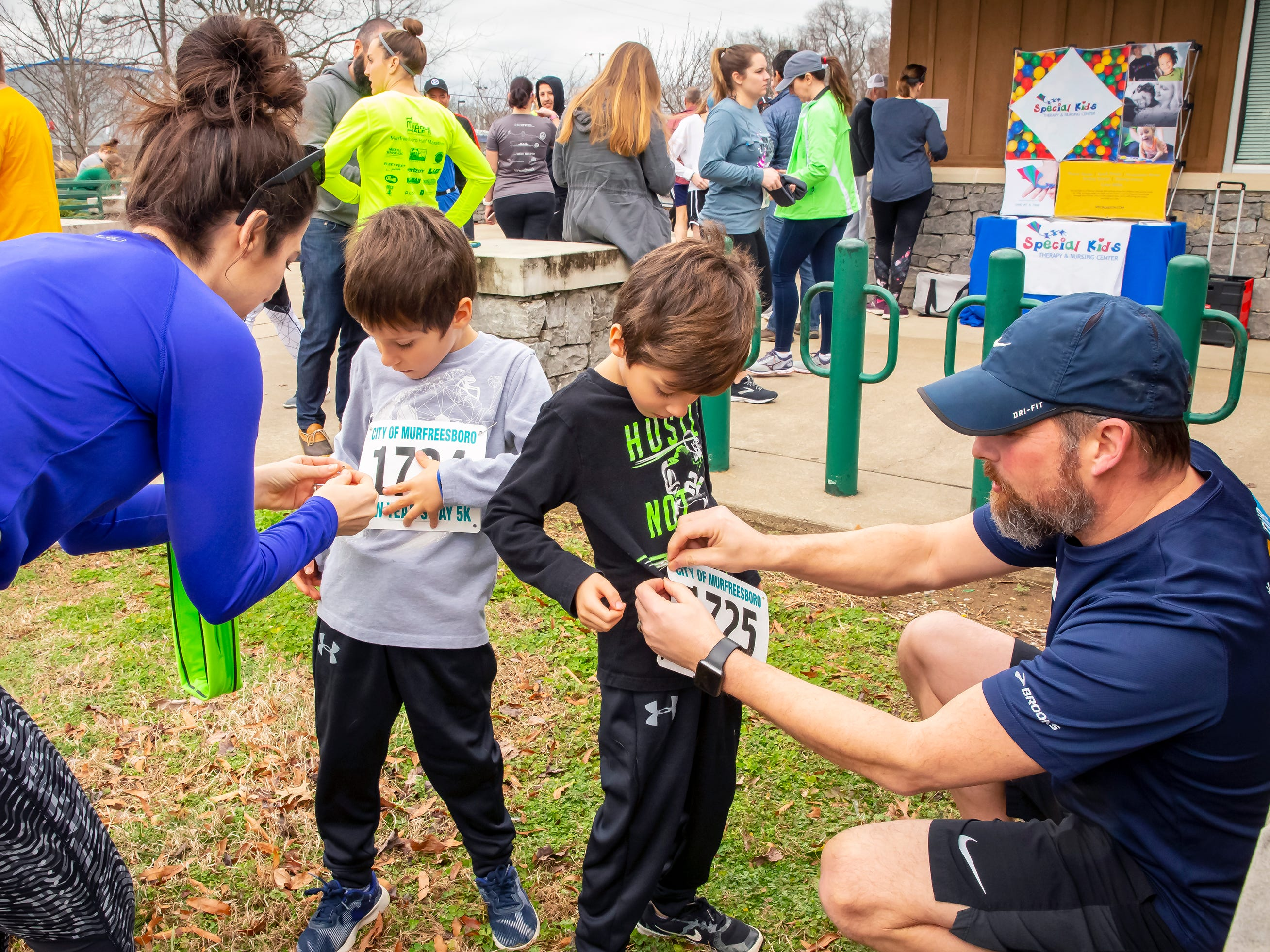 The Park family, Brandi, Brian, Aiden and Austin prepare for the New Year's Day 5K event held at Old Fork Park on Jan. 1, 2019.