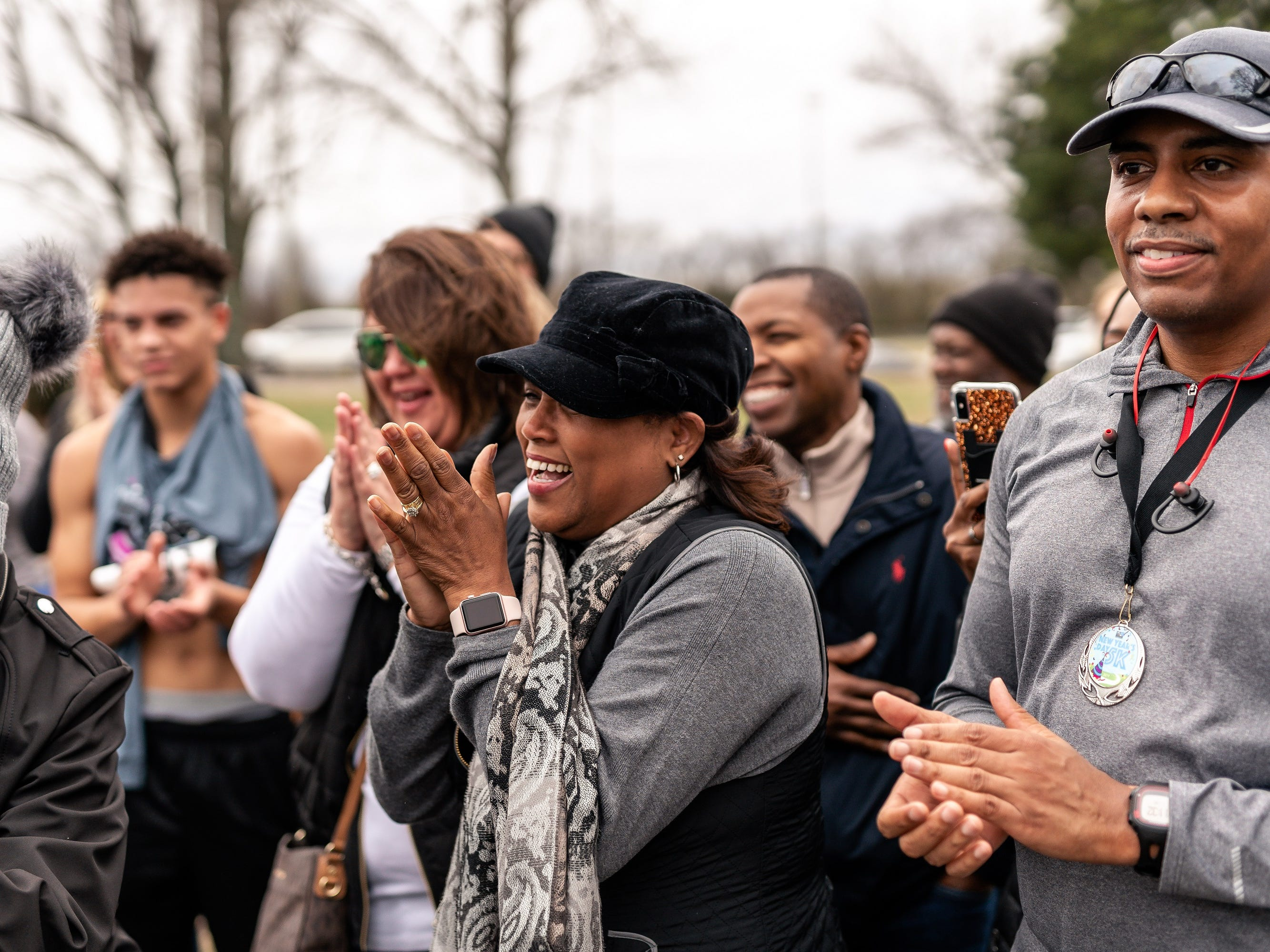 Friends and family were present when Joshua Crutchfield proposed to long-time girlfriend, Tiffany Smith, after they finished the Murfreesboro New Year's Day 5K.