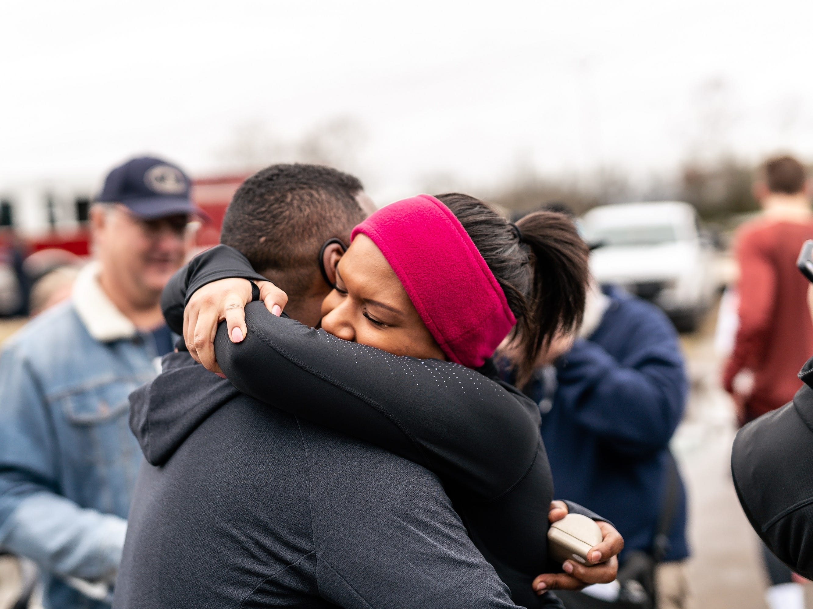 Joshua Crutchfield and Tiffany Smith embrace after getting engaged following the Murfreesboro New Year's Day 5K.