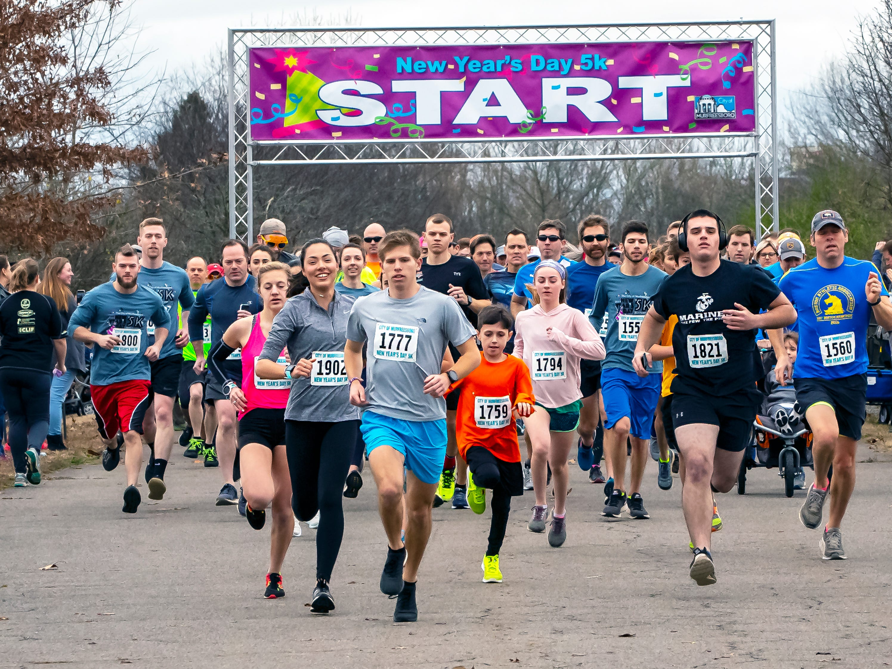 Daniel Smith (bib 1777) and eventual overall winner, leads the start of the 2019 New Year's Day 5K event held at Old Fort Park.