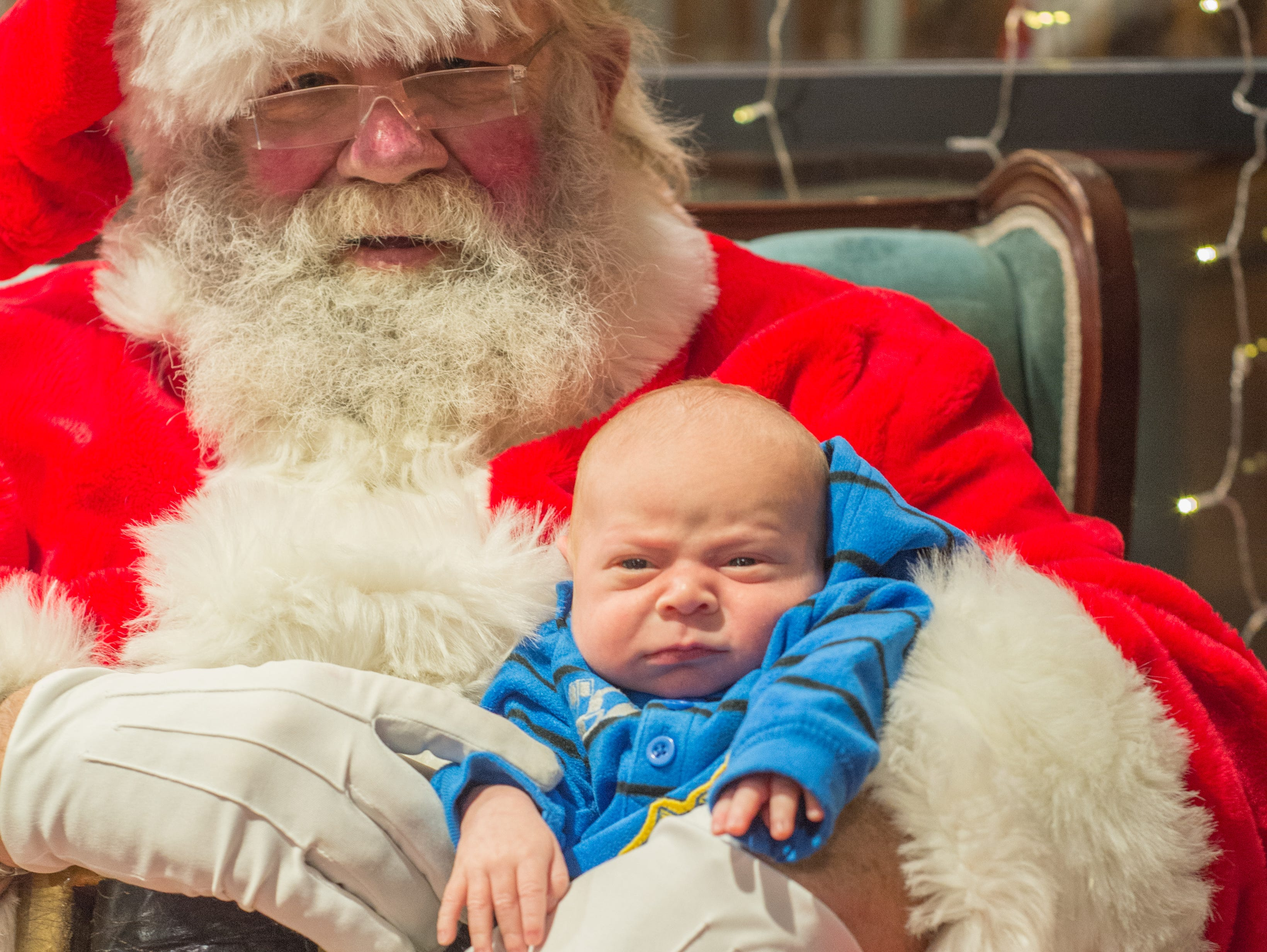 Izaiah Johnson meets Mr. Claus for the first time during the Santa on the Square event presented by Historic Downtown Gallatin at 106 Public Square on Saturday, Dec. 22.