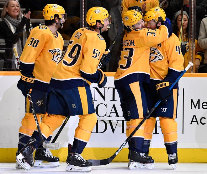 Predators right wing Viktor Arvidsson (33) is congratulated by teammates after his goal during the third period against the Flyers at Bridgestone Arena Tuesday, Jan. 1, 2019, in Nashville, Tenn.