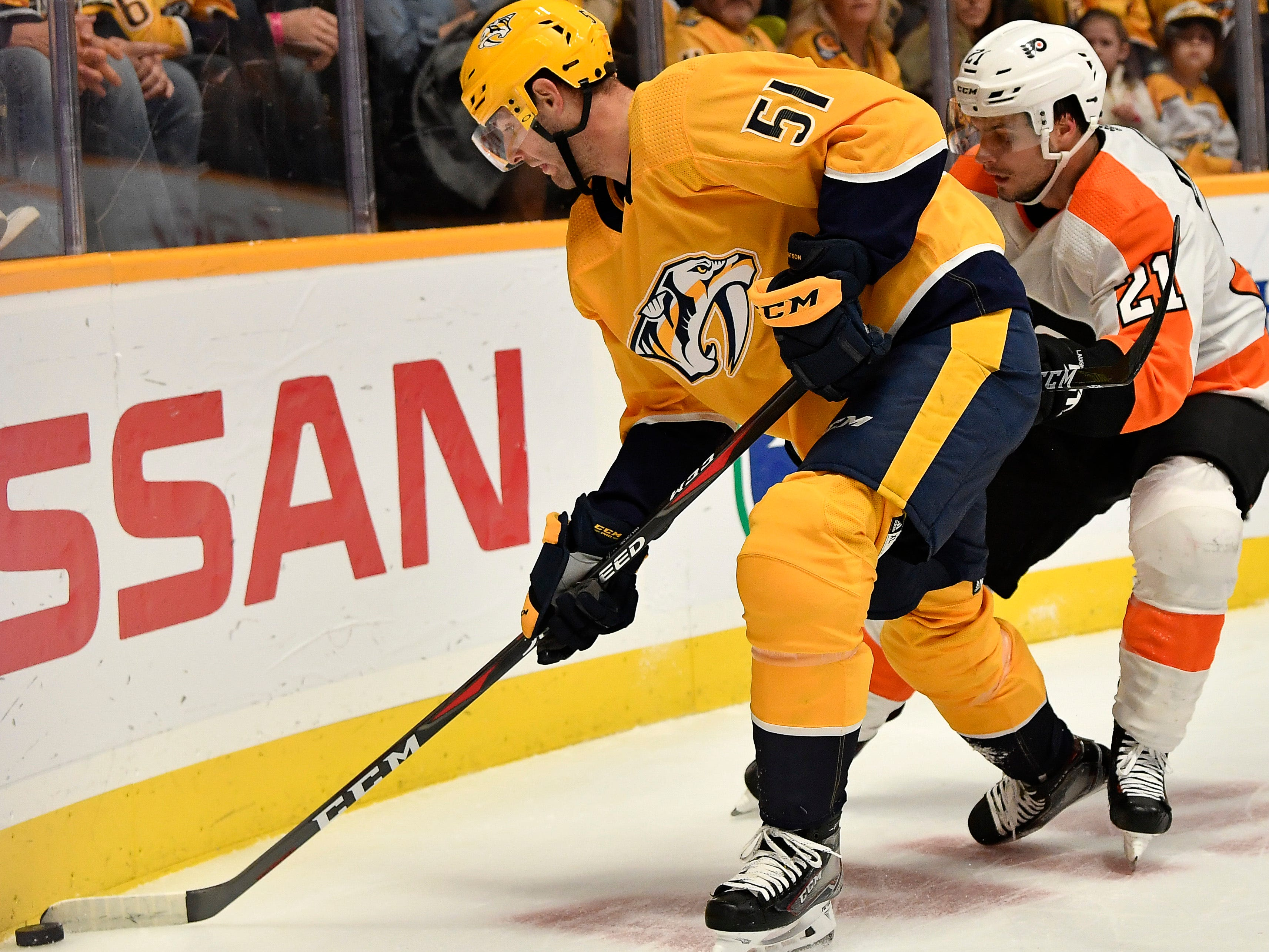 Predators left wing Austin Watson (51) keeps the puck from Flyers center Scott Laughton (21) during the first period at Bridgestone Arena Tuesday, Jan. 1, 2019, in Nashville, Tenn.