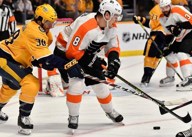 Predators right wing Ryan Hartman (38) tries to take puck from Flyers defenseman Robert Hagg (8) during the first period at Bridgestone Arena Tuesday, Jan. 1, 2019, in Nashville, Tenn.