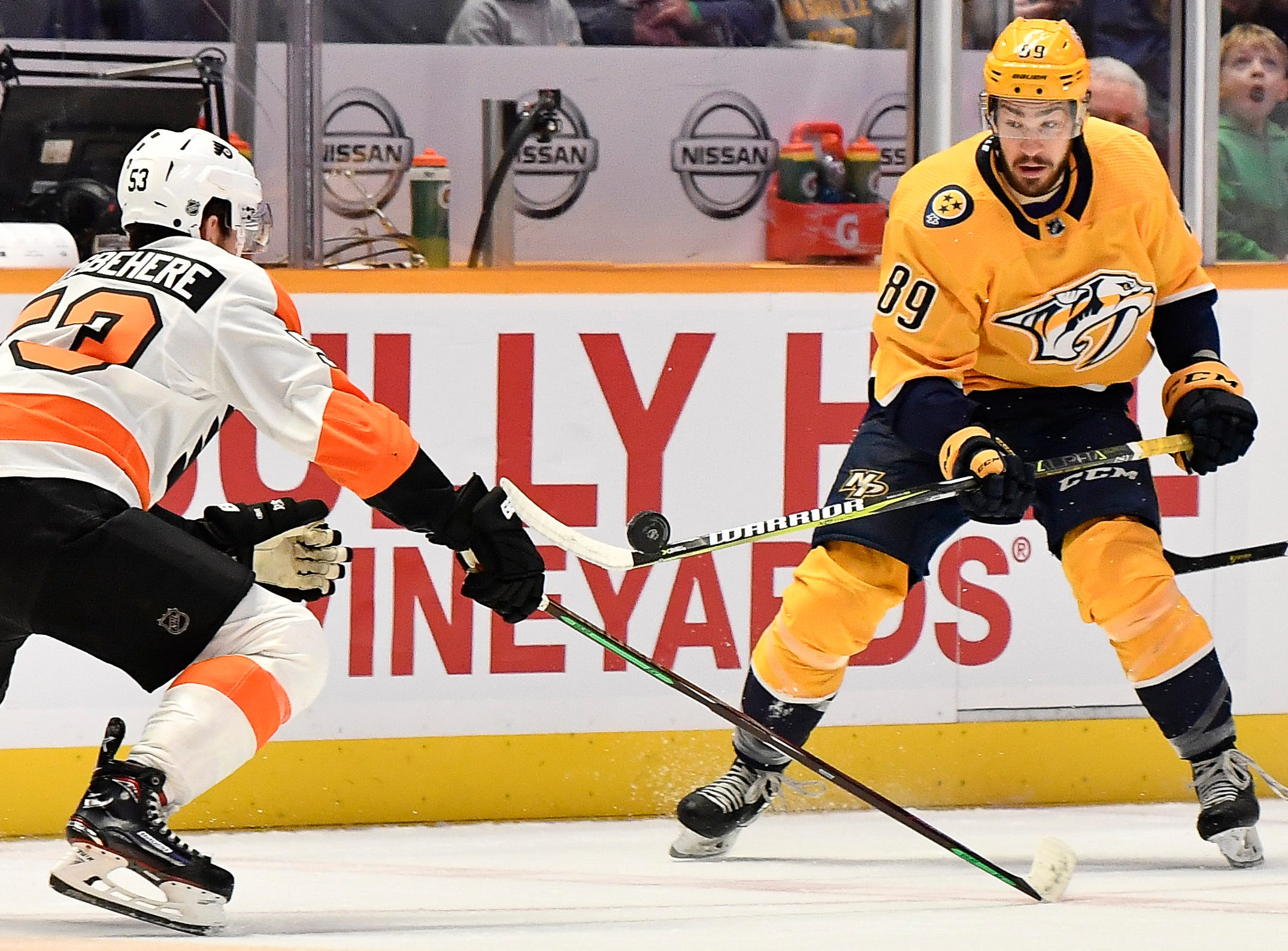Predators center Frederick Gaudreau (89) takes the puck from Flyers defenseman Shayne Gostisbehere (53) during the first period at Bridgestone Arena Tuesday, Jan. 1, 2019, in Nashville, Tenn.