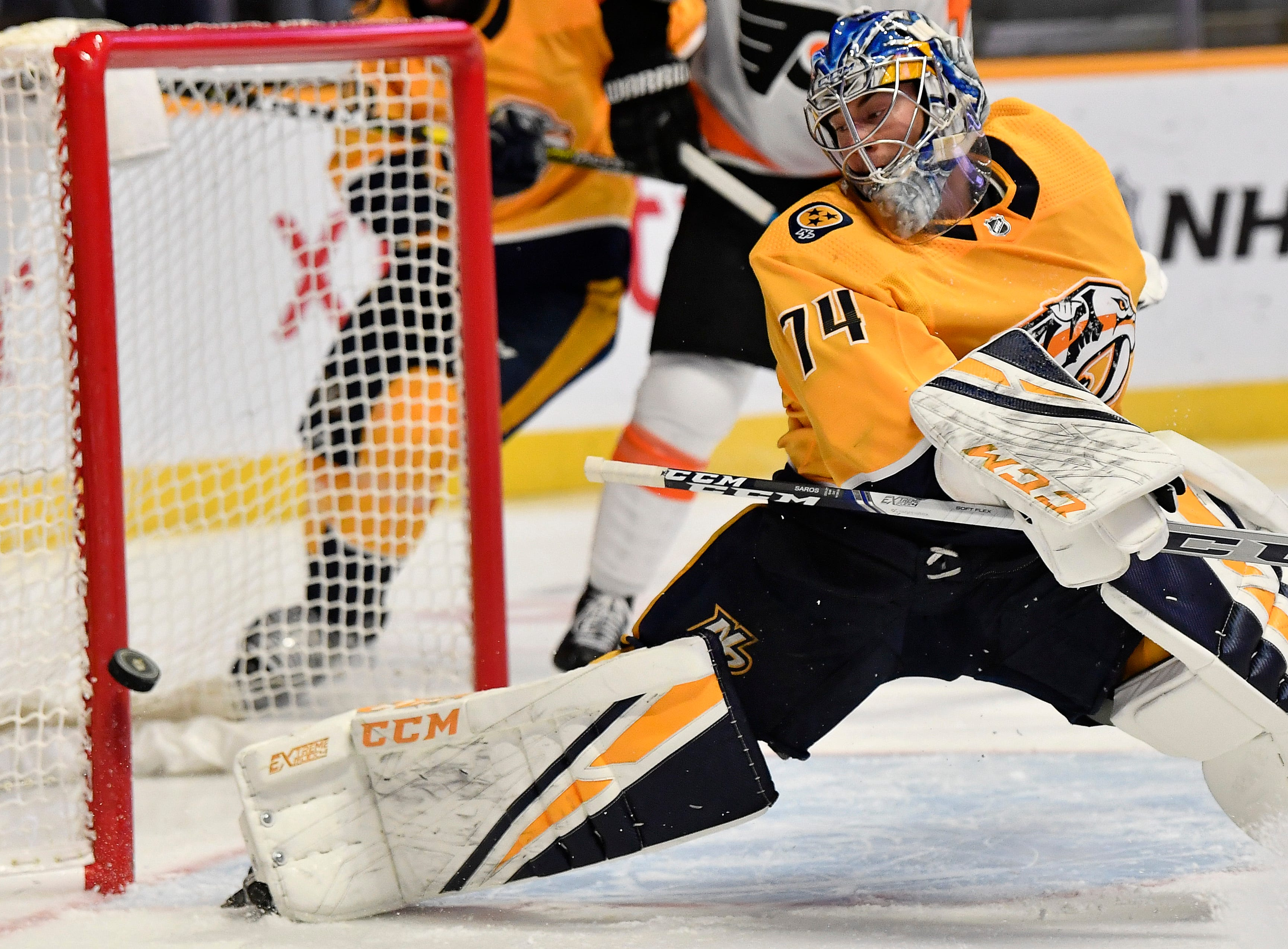 Predators goaltender Juuse Saros (74) blocks a shot on goal during the second period against the Flyers at Bridgestone Arena Tuesday, Jan. 1, 2019, in Nashville, Tenn.