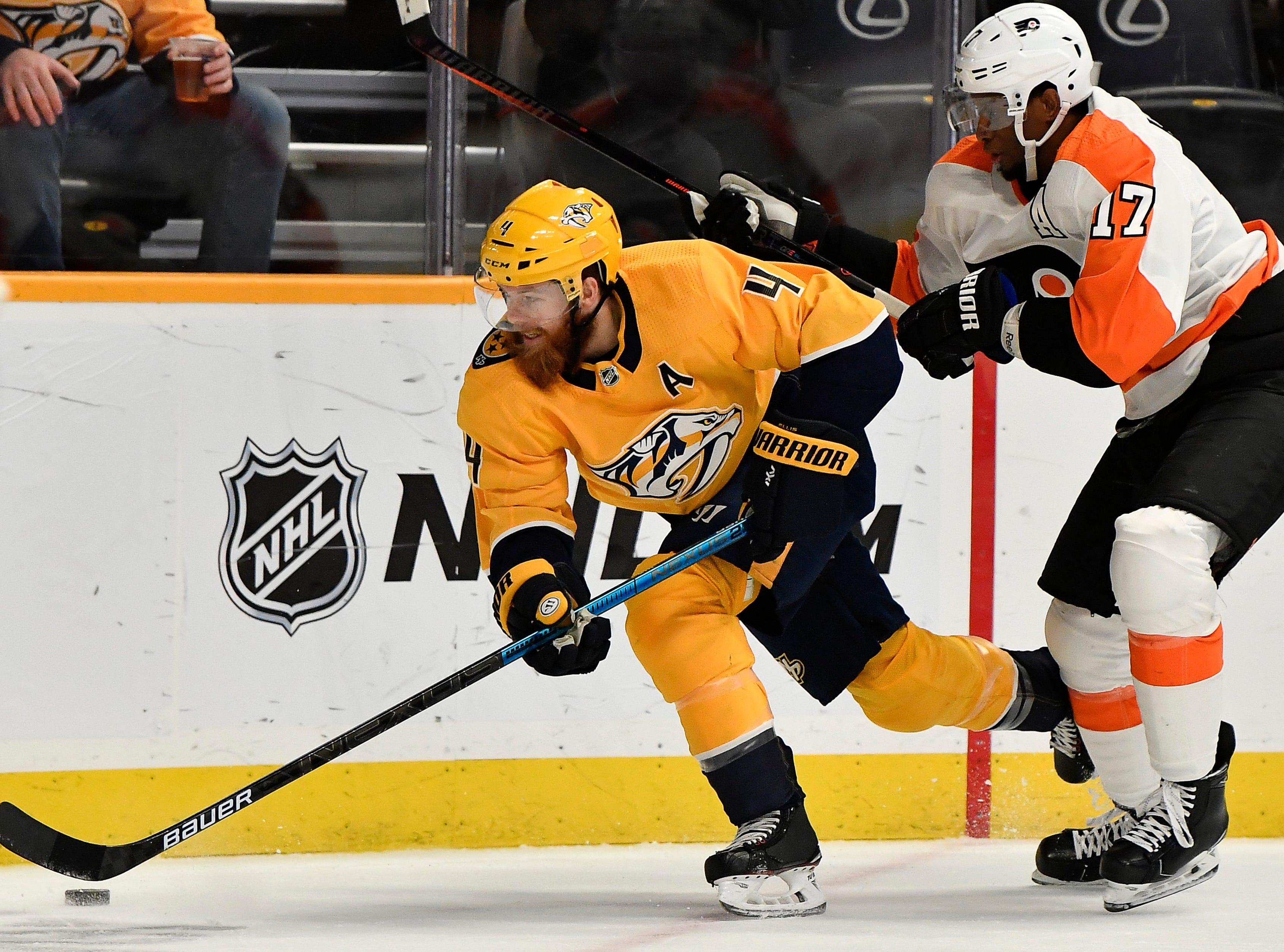 Predators defenseman Ryan Ellis (4) takes the puck from Flyers right wing Wayne Simmonds (17) during the second period at Bridgestone Arena Tuesday, Jan. 1, 2019, in Nashville, Tenn.