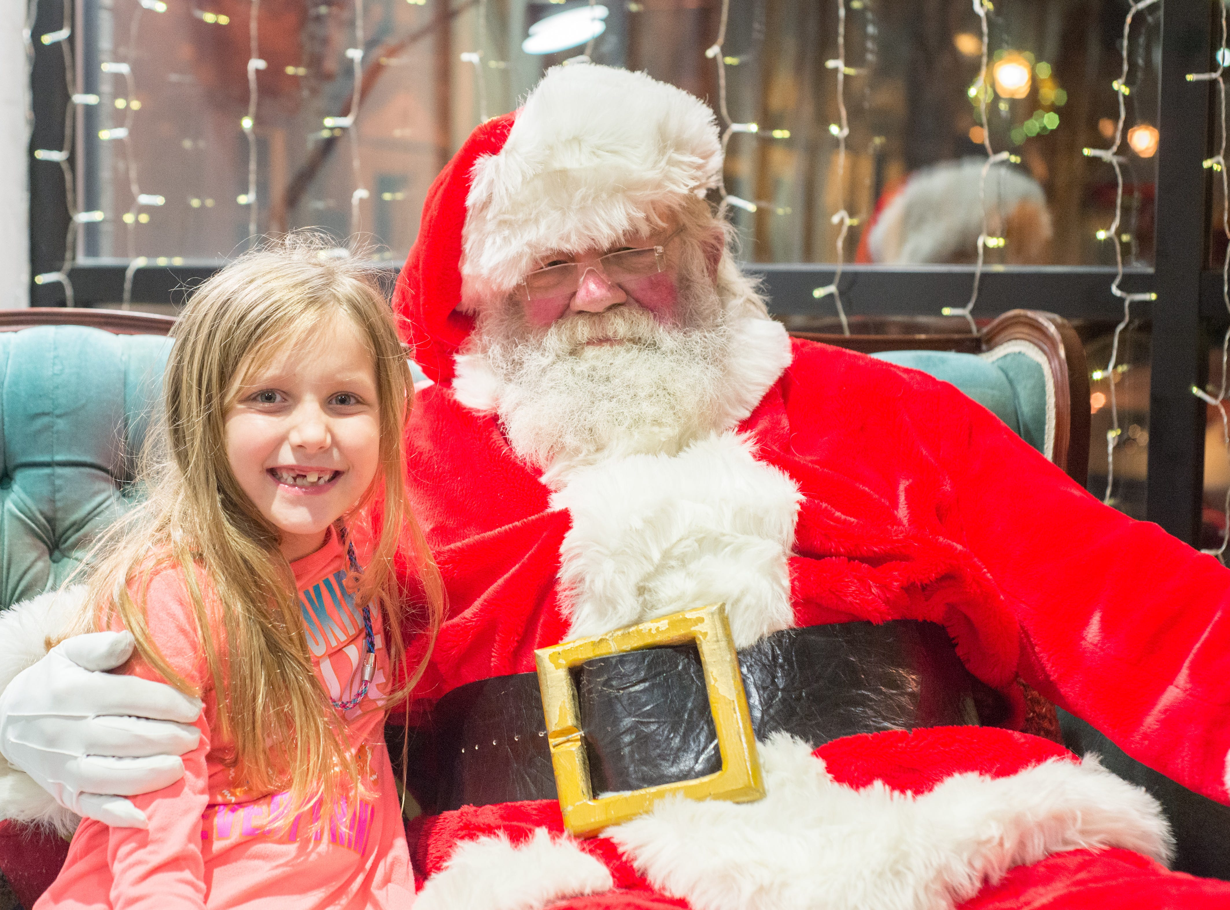Zoey Johnson chats with Mr. Claus during the Santa on the Square event presented by Historic Downtown Gallatin at 106 Public Square on Saturday, Dec. 22.