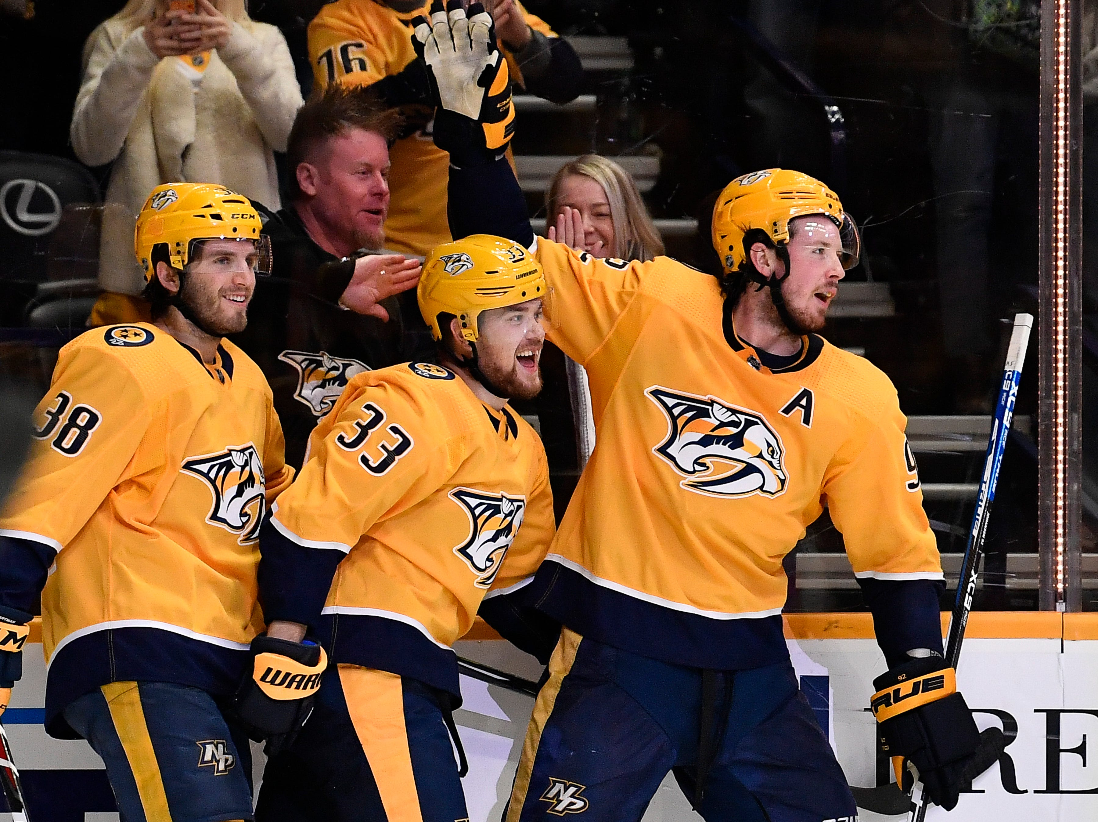 Predators Ryan Hartman (38) and Ryan Johansen (92) congratulate right wing Viktor Arvidsson (33) after his goal during the third period against the Flyers at Bridgestone Arena Tuesday, Jan. 1, 2019, in Nashville, Tenn.