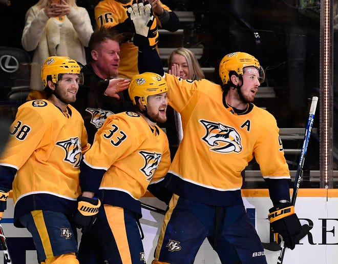 The Predators' Ryan Hartman (38) and Ryan Johansen (92) congratulate right wing Viktor Arvidsson (33) after his goal during the third period against the Flyers on Jan. 1.