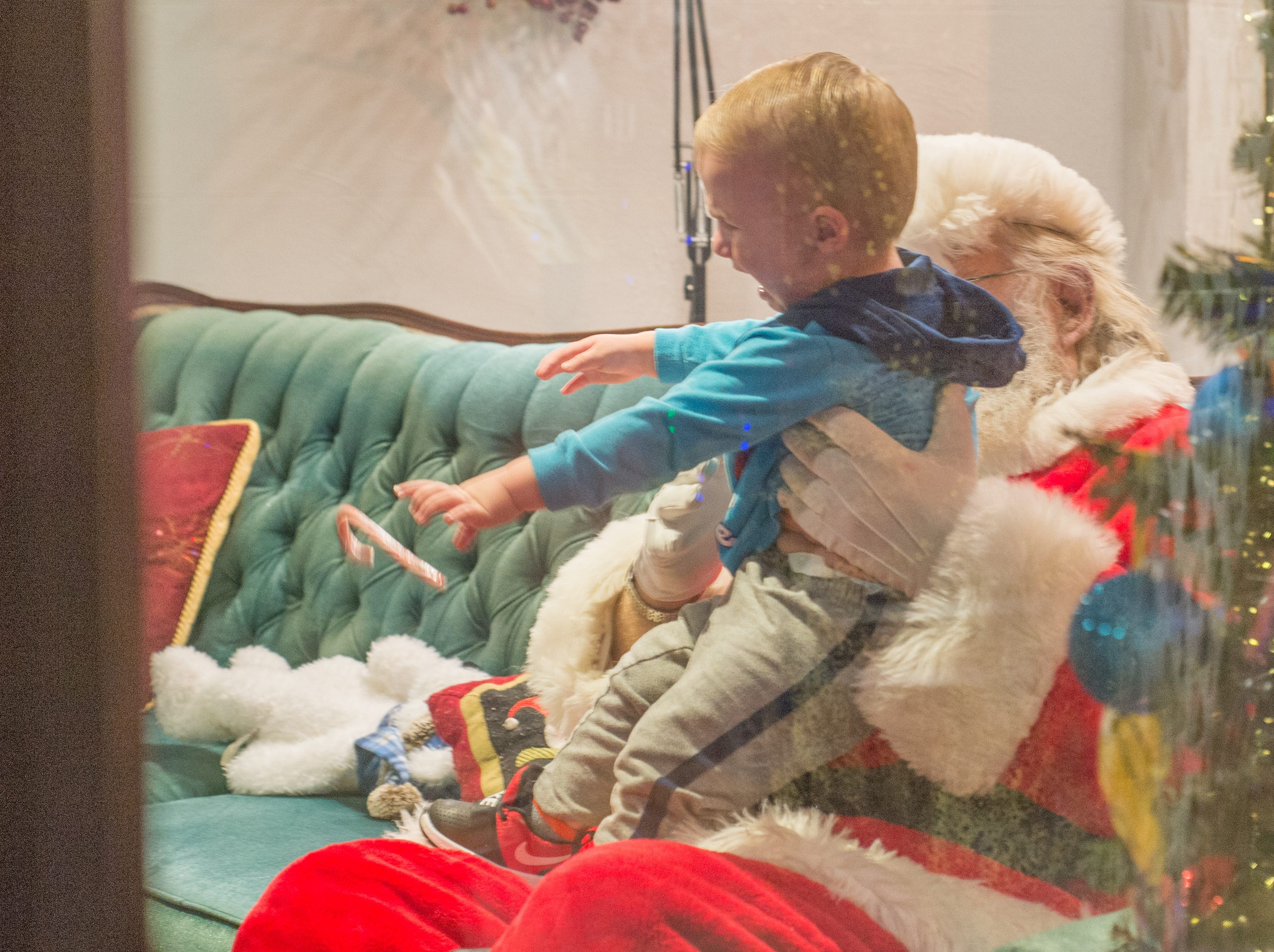 Not everyone was thrilled to meet Mr. Claus during the Santa on the Square event presented by Historic Downtown Gallatin at 106 Public Square on Saturday, Dec. 22.