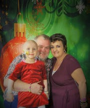 Haleigh Peden with her parents Jerry and Rhonda Clemons when she had cancer the first time.