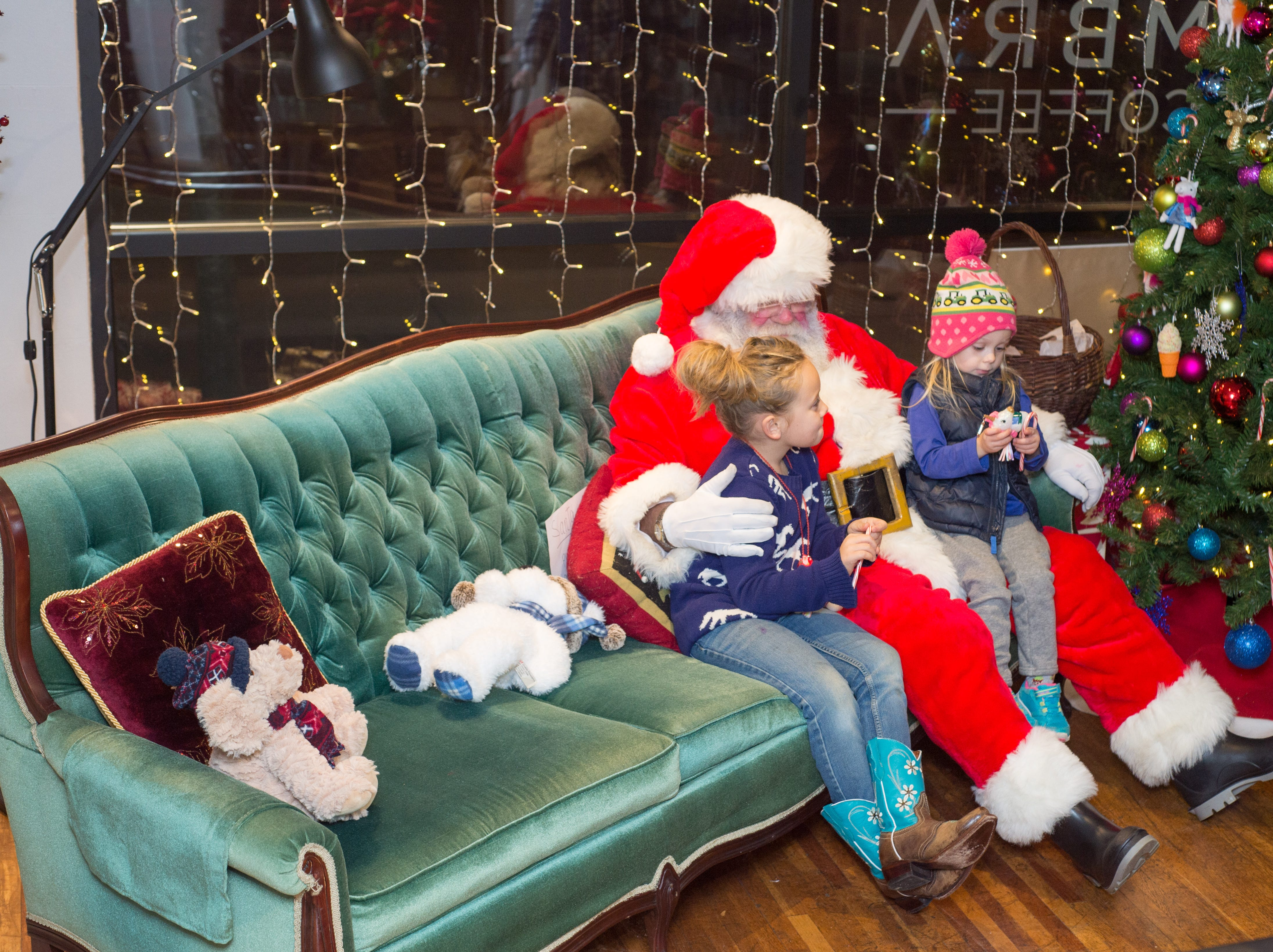 Vera and Etta have fun during the Santa on the Square event presented by Historic Downtown Gallatin at 106 Public Square on Saturday, Dec. 22.