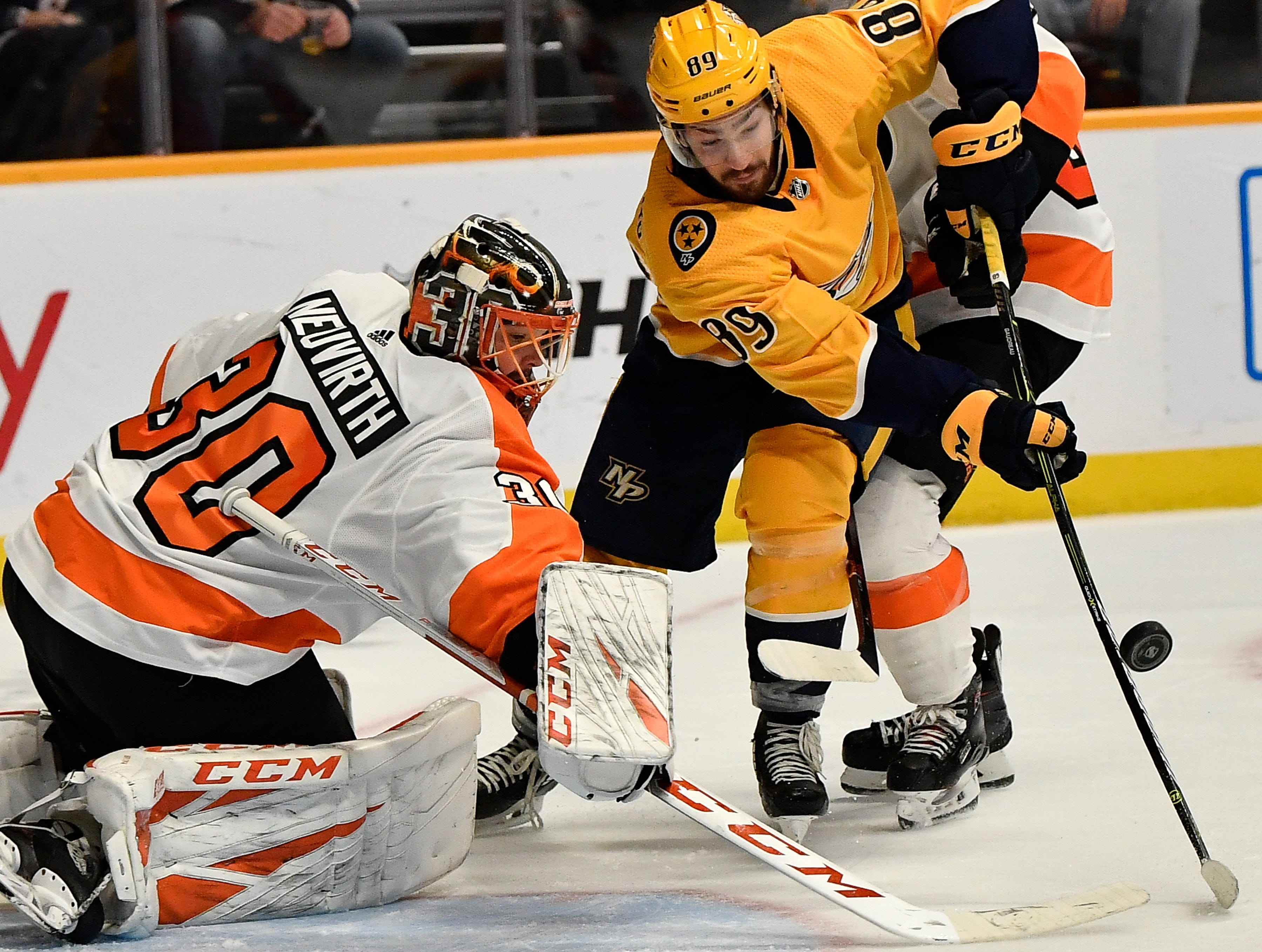 Predators center Frederick Gaudreau (89) tries to get the puck past Flyers goaltender Mich