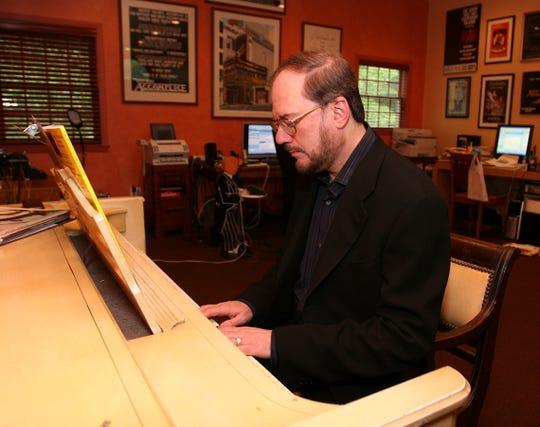 Rupert Holmes composes at his piano at home.