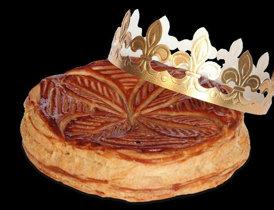 The King Cake at Sook Bakery comes with a gold paper crown.