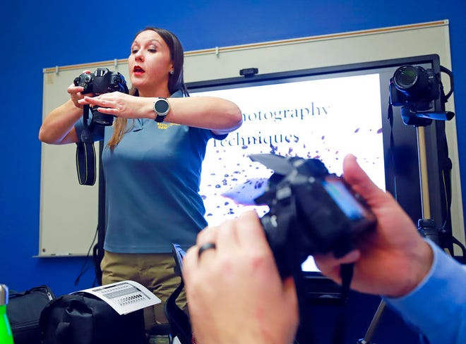 Shari Vialpando, crime scene tech for the Santa Fe County Sheriff Office, shows detectives various angles to use photographing on crime scenes.