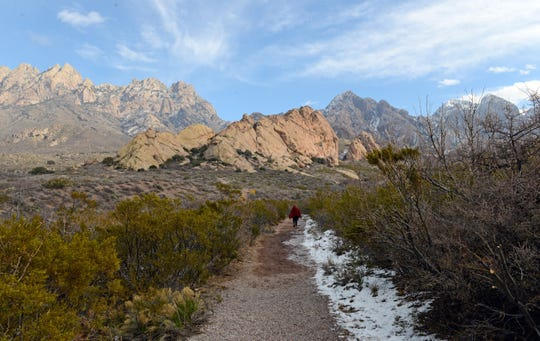 Mary Lucas, of Las Cruces, hikes the La Cueva trail at Dripping Springs Natural Area on Wednesday, Jan. 2, 2019, even though signs at the entrance to the area said it was closed because of the partial government shutdown.