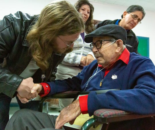 Ambercare hospice chaplain Patrick Crocker takes a moment to congratulate and thank  World War II veteran Albert Rel, 94, who was recognized on Saturday Dec. 29, 2018, by the Veteran's Administration at Immaculate Heart of Mary Catholic Church.