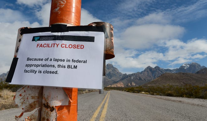 A sign at the entrance to the Dripping Springs Natural Area in New Mexico says it is closed because of the partial government shutdown on Wednesday, Jan. 2, 2019.
