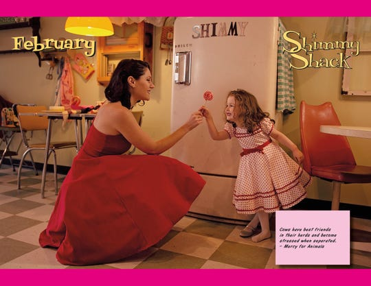 Calendar models pose in 1950s-style attire to complement the mid-century decor at the new Shimmy Shack restaurant.