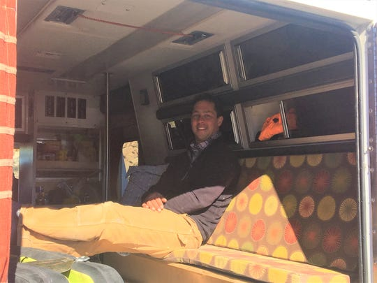 Steve Vindler sits in his vehicle at Joshua Tree National Park. The Alaska man was among the campers who had to leave their campgrounds, which were shut down Wednesday.
