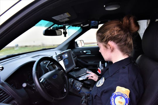 Officer Adrienne Marcionette, of Penn Township Police Department, is working in a police car on Jan. 2, 2019.