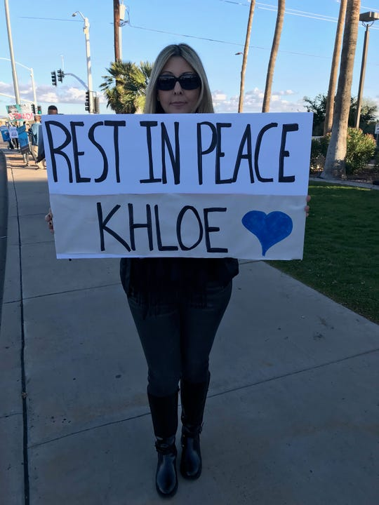 "A protester holds a sign reading ""Rest In Peace Khloe,"" to honor a 10-year-old bottlenose dolphin that died Sunday at the Scottsdale Dolphinaris Arizona."