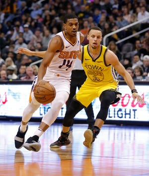 Phoenix Suns guard De'Anthony Melton (14) in the first half during an NBA basketball game against the Golden State Warriors, Monday, Dec. 31, 2018, in Phoenix. (AP Photo/Rick Scuteri)