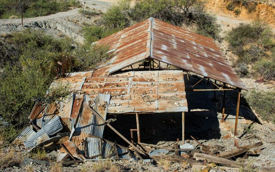 An abandoned blacksmith shop sits on an abandoned mine site near Wickenburg. There are an estimated 100,000 abandoned mines in the state and only a fraction are fenced off or gated to keep people out.