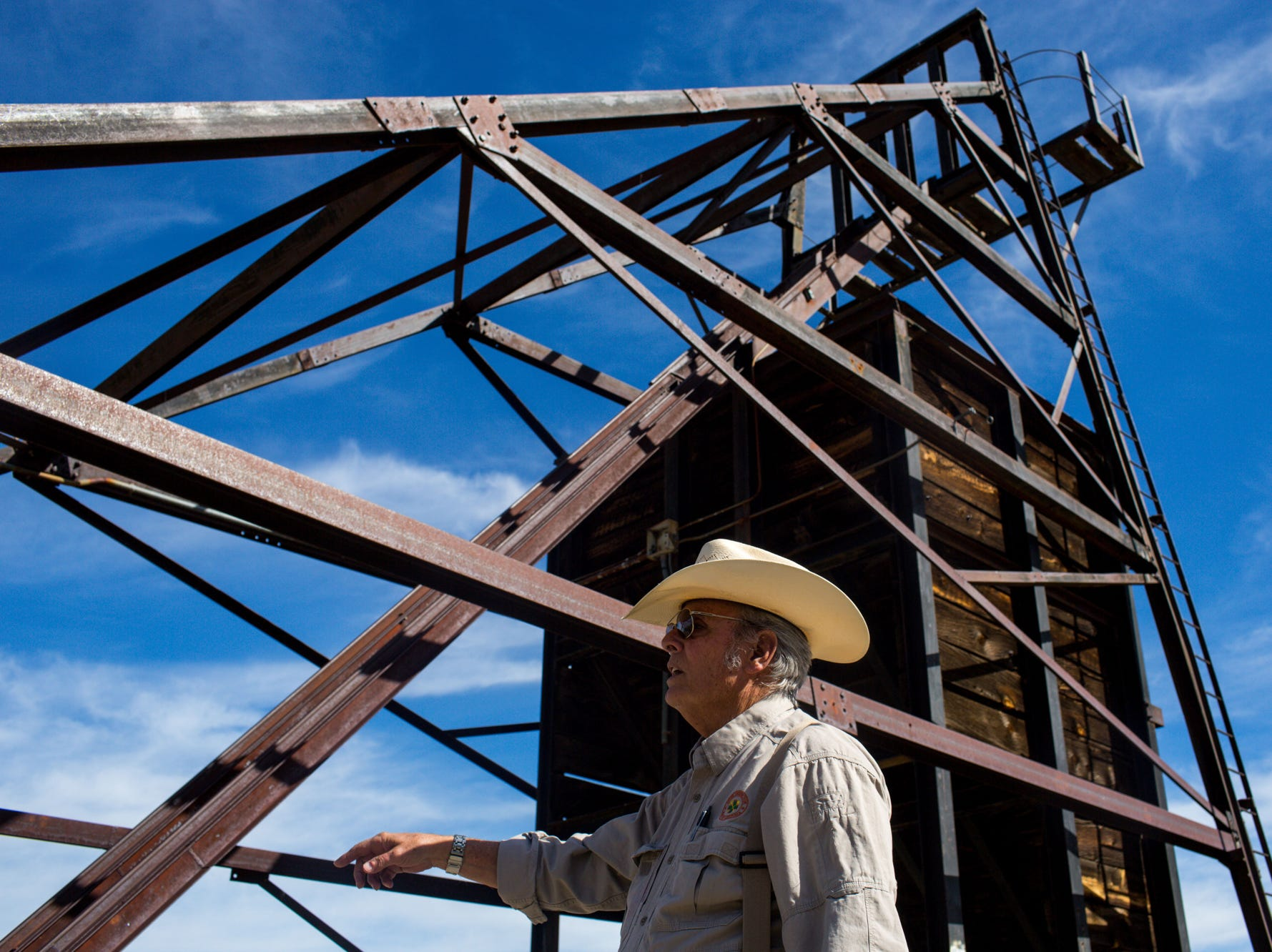 Jerry Tyra fits the classic image of an Old West sheriff: silver hair, a straw cowboy hat and a cigarette often between his lips. But as one of Arizona's only abandoned-mine supervisors, he is protecting people from a menace created during the Old West: ore mines, like this one, abandoned throughout the state.