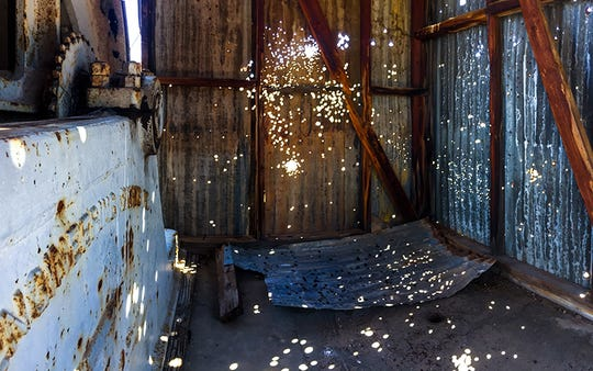 This shack was once used for pulling ore carts at a now-abandoned mine near Wickenburg. It's filled with bullet holes from people shooting firearms out here over the years.