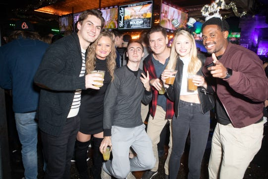 The Whiskey Row Block Party on Mill Avenue was a hotspot on New Year's Eve on Monday, Dec. 31, 2018 in Tempe.