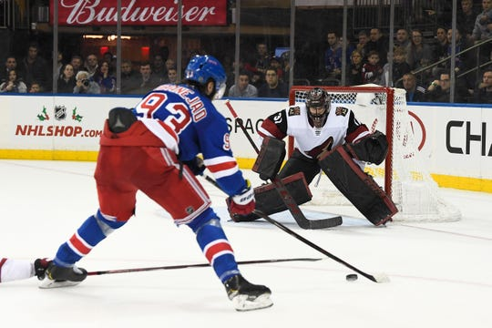 Rangers center Mika Zibanejad lines up a shot against Coyotes goalie Adin Hill  during overtime of a game Dec. 14 at Madison Square Garden.