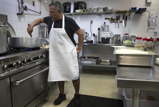 Eddie Caliendo works in the kitchen on December 13, 2018, at AZ Food Crafters, 961 West Ray Road, Chandler.
