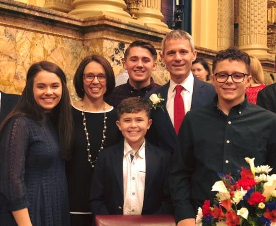 Rep. Rob Kauffman, pictured with his family, was sworn in as state representative of the 89th Legislative District on Jan. 1. He  also has been named chairman of the House Judiciary Committee.